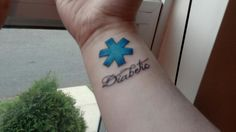 "A female paramedic has this one.  Like the script of ""Diabetic"" but not the blue cross....and it needs to face the other direction."