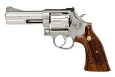 "Smith & Wesson Model 686 - my baby ""You woke the baby!"" Sadly I sold my baby to aquire a more concealable gun."