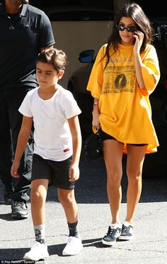 Just us: Kourtney Kardashian had all eyes on her as she sported a bright yellow vintage oversized shirt while taking her son Mason to an art class in Los Angeles on Tuesday Baggy Tshirt Outfit, Oversized Shirt Outfit, Outfit Jeans, Oversized Tee, Shirts & Tops, Trendy Outfits, Cute Outfits, Big Shirt Outfits, Camila
