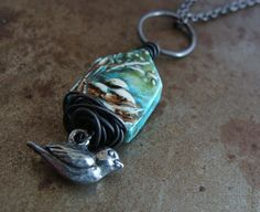 A precious nest is filled with a trio of eggs in this house shaped pendant - symbolizing home and family. $45.00