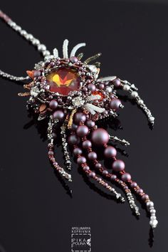Petelin Pendant // bead weaving and bead embroidery techniques #swarovski #beadweaving #embroidery #iridescentred
