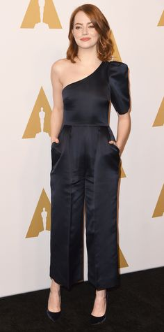 Look of the Day - Emma Stone wore the chicest jumpsuit to the Academy Awards nominees luncheon: a one-sleeved silk one-piece Stella McCartney, styled with jewelery by Fernando Jorge and Sara Weinstock, and black Jimmy Choo pumps.