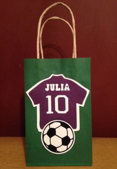 Soccer Goody Bags I made for the girls in Lucas' 4th Grade Class.  Purple Jerseys, with their name and the #10 in honor of his 10th Birthday, and of course, a soccer ball. Lucas' 10th Birthday 2014