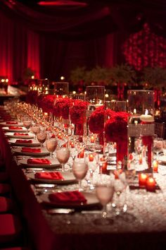 Luxury red wedding reception centerpieces with floating candles