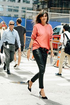 Emmanuelle Alt has mastered the classic tuck—a 5- to 6-inch span of the top tucked loosely into the center front of the trousers. Works best with an oversize shirt, modern belt, and Alt-worthy heels.