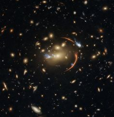 The center of this image from the NASA/ESA Hubble Space Telescope is framed by the tell-tale arcs that result from strong gravitational lensing, a striking astronomical phenomenon which can warp, magnify, or even duplicate the appearance of distant galaxies. Nasa, Cosmos, Astronomy Pictures, Hubble Images, Hubble Space Telescope, Deep Space, Lens Flare, Space Exploration, Science