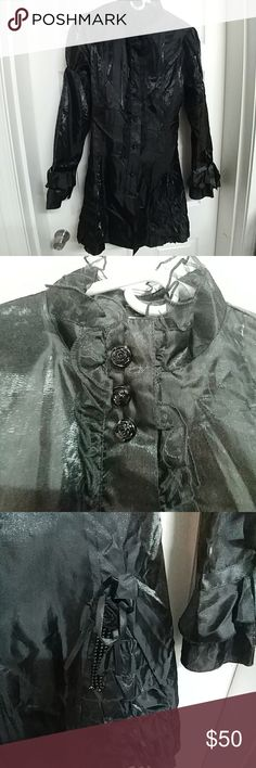 Lacy Goth coat Living Dead Souls coat. Tag says XXL but it runs small. Fits more like a Large. Lace collar. Ruffled sides. Ties in the back. Buttons up the front are decorative. Full zip underneath. Only worn a handful of times. Way more detail than what my camera shows.  All items come from a smoke-free 🚭, cat-friendly 🐱 home.   I don't do trades, but I'll consider reasonable offers. Please see my Reasonable Offers listing for details.  Thank you for looking!  Item #WC24 Living Dead Souls…