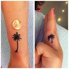Palm tree tattoo on hand finger