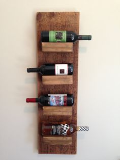 4 Bottle Wall Mount Wine Rack by ReclaimedArt717 on Etsy                                                                                                                                                                                 Mais