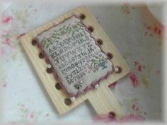 by CrossStitchFairy    Nina's Threads: Hell's Garden, Hunter,Steel, Burgundy, Cherry Cola  Nina's linens: Honey light  Hand dyed ric-rac by Nina