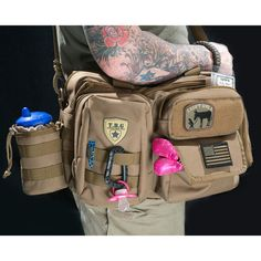 Tactical Baby Gear Hardcore Baby Bags  Amp up the aesthetic of on-the-go parenting with these rugged, mega-versatile bags from Tactical Baby Gear. With no frills, no fuss and no cutesy graphics, these bags are not messing around. Customizable and fully functional, they'll carry absolutely everything you need, and prepare you for the battlefield of diapers, band-aids, snacks and extra clothes.  Diaper Bag Combo Set (Coyote Brown)