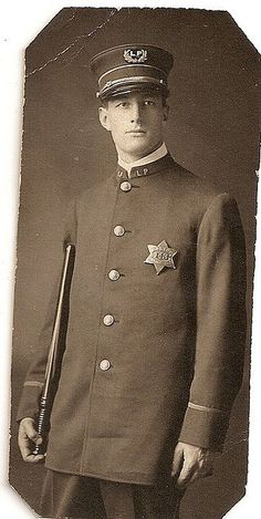 Portrait of a Chicago Police Officer, Lincoln Park beat (hence the LP on his cap and lapels), c.1910's, Chicago.