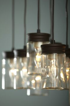 Reminiscent of jelly jars this multi pendant light is a statement lighting over a dining room table mozeypictures Gallery
