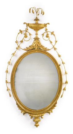 A George III giltwood and gilt-composition oval pier mirror circa 1785
