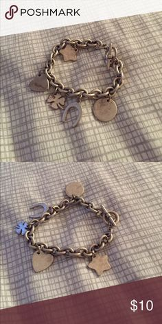 American Eagle Charm Bracelet Stainless steel charm bracelet. Really comfortable, although not adjustable. Worn twice. Feel free to make an offer 😁 American Eagle Outfitters Jewelry Bracelets
