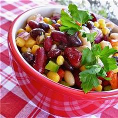 Mexican Bean Salad- A favorite at our house. I add fresh diced tomatoes, reduce the amount of oil and vinegar, and leave out the sugar.