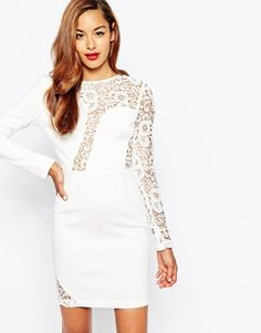 White bodycon dress with lace details. A bachelorette weekend and bachelorette party look.