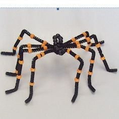 HALLOWEEN SPIDER CRAFT: Pipe cleaners and pony beads combine to makethis creepy crawly spider.