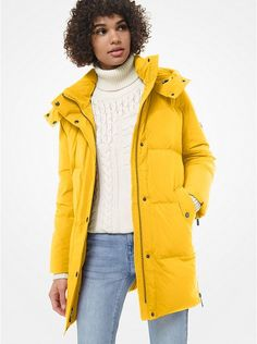 Yellow Quilted Down Puffer Jacket Michael Kors.  Cut in a mid-length silhouette, it's detailed with detachable hood and side zips that create a tactile element and allow for a more relaxed fit.  #Fashion #LookBook #OutfitOfTheDay #LookOfTheDay  #Fashionable #FashionStyle  #FashionAddict #FashionLover #Fashionista #FashionStylist