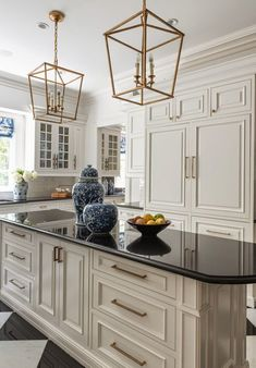 and White Kitchen Floor, Transitional, Kitchen, Les Ensembliers White Kitchen Floor, White Kitchen Cabinets, New Kitchen, Kitchen Decor, Kitchen Black, Gold Kitchen Hardware, Kitchen With Black Countertops, Black Granite Countertops, Cabinet Hardware