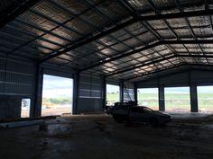Ultraspan custom building. View from inside, insulated roof, roller door openings. Built by Kieren Lee Plumbing & Construction 0428690696