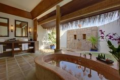 Kanuhura in the Maldives. Guests enjoy our custom fragrance, Verde Frangipani in the bath.