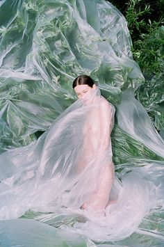 Girl plastic wrapped naked