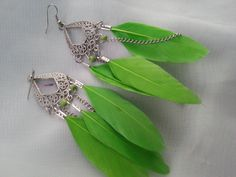 Neon Lime Green Feather and Silver Chandelier Earrings Goose. $6.50, via Etsy.