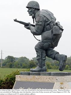 "With World War II-era military planes darting overhead and Normandy's Utah Beach visible in the distance, a bronze statue emerged from beneath a camouflage parachute, in tribute to a man whose quiet leadership was chronicled in the book and television series ""Band of Brothers."" The unveiling of the Colorado-made statue of Pennsylvania native Maj. Dick Winters was one of many events marking Wednesday's 68th anniversary of D-Day, the Allied operation that paved the way for the end of the war."