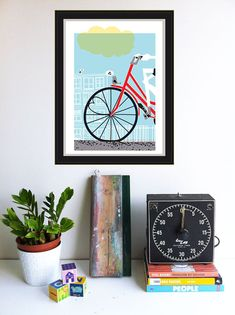 """Here is our hand screen printed Bicycle Art Print: """"Going To See My Baby Blue"""" hanging in our studio, with a well-used squeegee too. This print is a hand silkscreen printed Bike & Love Art Print by strawberryluna. (Available in my Etsy shop!)"""
