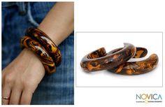 Google Image Result for http://www.mymilkglassheart.com/wp-content/uploads/2010/08/pair-of-mango-wood-cuff-bracelets-novica.jpg