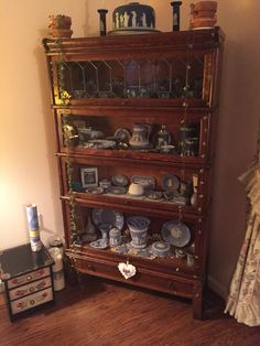 My Globe Wernicke bookcase with leaded glass and Wedgewood jasperware collection