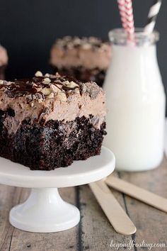 Sinful Triple Chocolate Poke Cake with a chocolate whipped cream frosting. This is the best chocolate cake you will ever have! Beyondfrosting.com