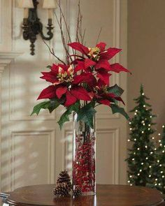 Last Trending Get all tall christmas decorations Viral c d b ad dbed a Christmas Flower Arrangements, Christmas Table Centerpieces, Christmas Flowers, Xmas Decorations, Christmas Vases, Poinsettia Flower, Centerpiece Ideas, Floral Arrangements, Christmas Mantels