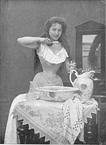 A woman at toilet during the Victorian Era.