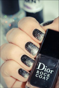 Black and silver ombre with sparkles on top.