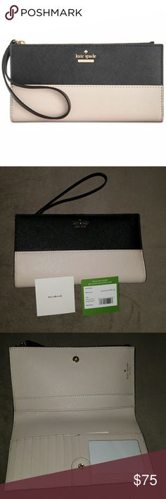 """Kate spade wallet Cameron street eliza Wristlet strapZip closure; linedExterior zip compartment, two interior slip pockets, nine interior card slotsLogo detail on front7.5""""W x 0.5""""D x 4""""HShell: cow leather coated with polyurethane; trim: cow leather; lining: polyesterImported kate spade Bags Clutches & Wristlets"""