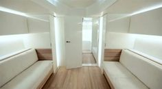 Yatch interior could be used in guest bedroom with pull down bunks and futon sofa beds