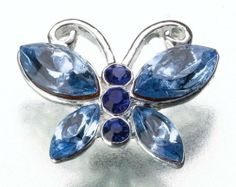 """Blue Butterfly Pin by Bridal & Baby Collection. $10.98. Blue Butterfly Pin. See Below for complete Product Description. This charming """"Something Blue"""" butterfly pin uses silver plating combined with shiny rhinestones in two different shades of blue. The pin measures 0.625"""" wide and 0.5"""" tall."""