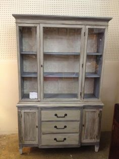 Refinished shabby chic china cabinet using chalk paint and wallpaper