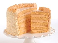 Fresh-squeezed 100% real Florida orange juice brightens all golden layers, filled with sweet creamy orange mousse and frosted with orange-cream cheese frosting. 12 pounds of Florida sunshine!