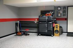 Clean Garage Wall Paint Ideas With Grey Color And Single Contrasting Red Center Stripe
