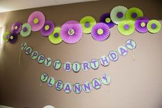 1st birthday decoration. Paper rossettes backdrop. Tinkerbell theme and a handmade birthday banner