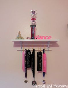 DIY trophy shelf -- The cheap and easy way to make your own shelf for showing kids' awards and trophies