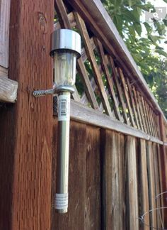 Solar lamp mounted on fence - interesting beginning concept. Finish off by adding some sort of base finial? Design up some way with being able to still place in eye screw.