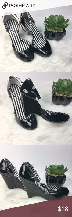BCBGirls Black Platform Wedge Heels Ankle Strap Beautiful Black wedges heel with ankle strap, inside is black and white stripes.  It has a scratch on the back of one heel (see pictures). Size 8.5M BCBGirls Shoes Wedges
