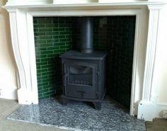 Woodburner with tiles behind