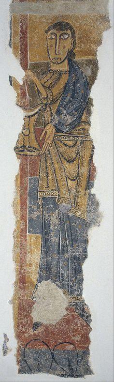 12th-cent.Romanesque Frescos of Santa Maria de Taüll.Unknown Romanesque Painter,Catalan (active 1100-1150 in Catalonia) Figure with vase from Santa Maria de Taüll. circa 1123.mural.Fresco transferred to canvas.4320x750 mm. Museu Nacional d'Art de Catalunya.
