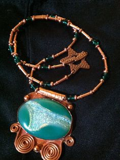 A druzy set in copper and strung with copper and emerald green glass  beads