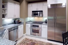 Chef-inspired premium stainless steel appliances allows for easier cooking at Rienzi at Turtle Creek Apartments in Dallas, TX.